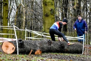 Sharon tackling one of the logs on the course